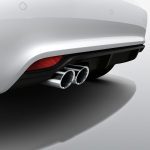 Rear diffuser, for vehicles with a twin tailpipe, primed
